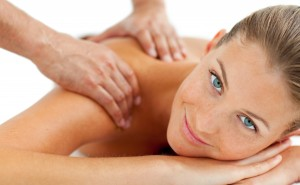 Smiling woman enjoying a massage